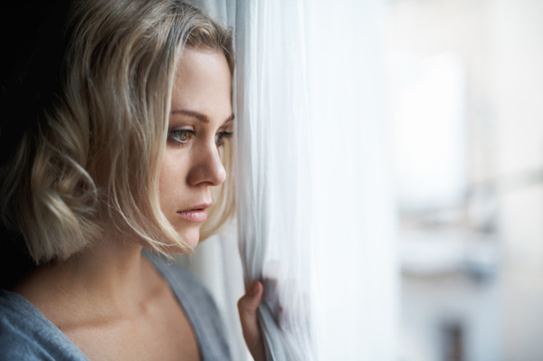sad-woman-looking-out-window1